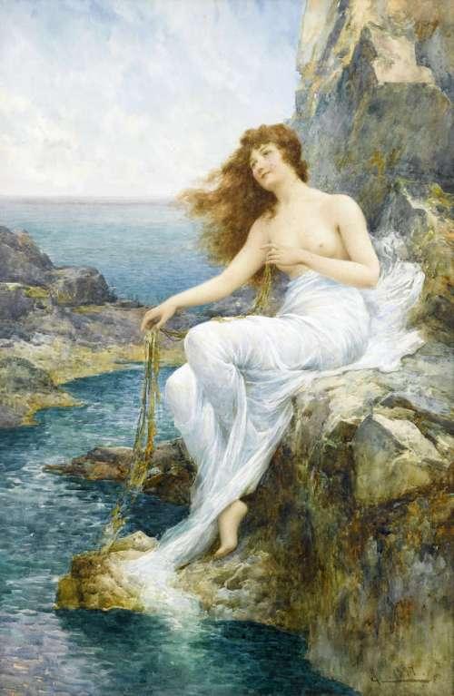 morska-deklica-na-skalni-obali